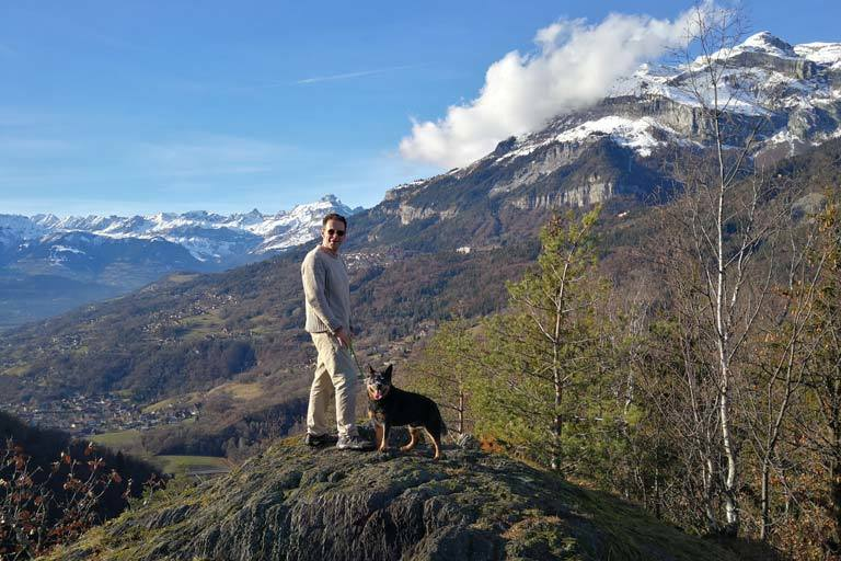 Hiking in the mountains with blue heeler